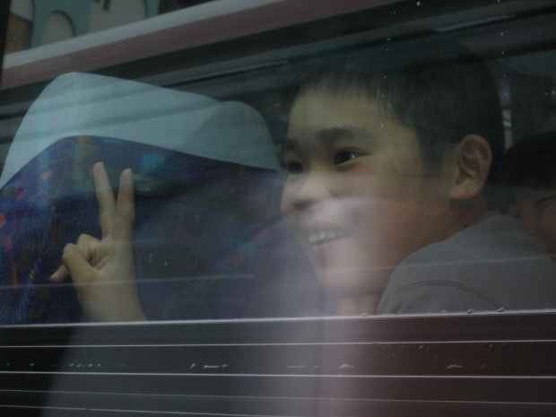 boy giving peace sign, Tokyo, Japan